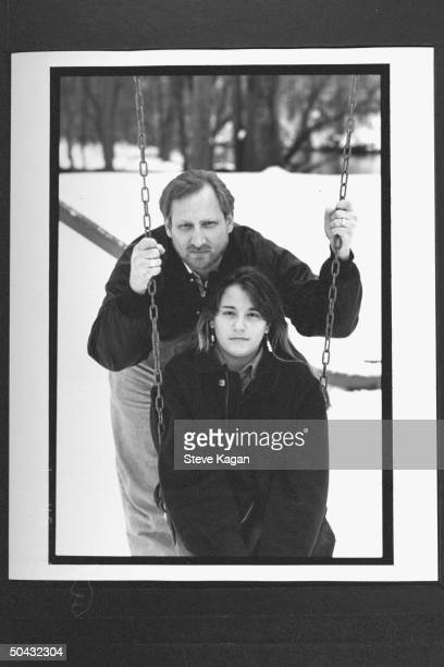 David Jewell standing behind his 12-yr-old daughter Kiri as she sits in swing in yard at home; Jewell fought for custody of Kiri & won when it was...