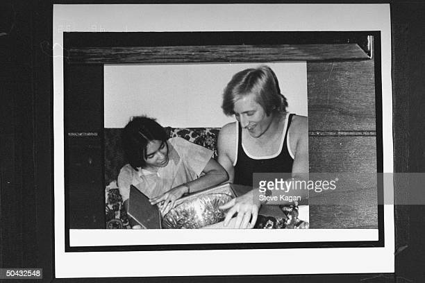 David Jewell w. Wife Sherri opening Christmas gift at home; Sherri joined the Branch Davidian cult in the mid-'80s, married its ldr. David Koresh,...