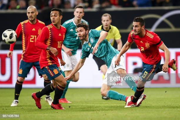 David Jimenez Silva Thiago Alcantara of Spain Jonas Hector of Germany and Jorge Koke Resurreccion of Spain jump for the ball during the International...