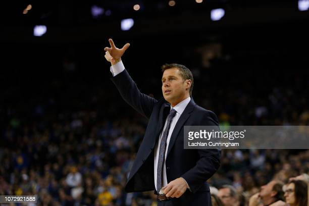 David Joerger head coach of the Sacramento Kings talks to the referee during the game against the Golden State Warriors at ORACLE Arena on November...