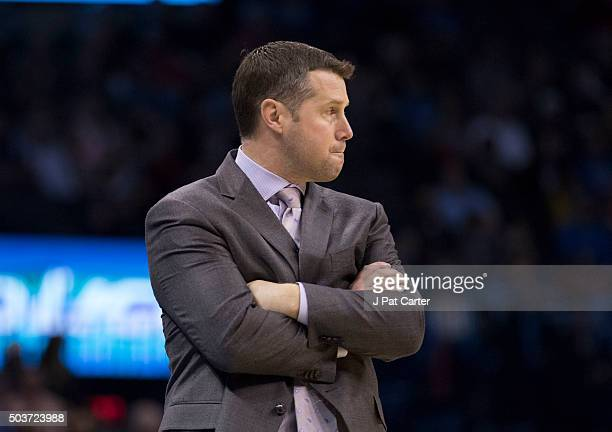 David Joerger of the Memphis Grizzlies reacts as he watches game action against the Oklahoma City Thunder during the first quarter of a NBA game at...