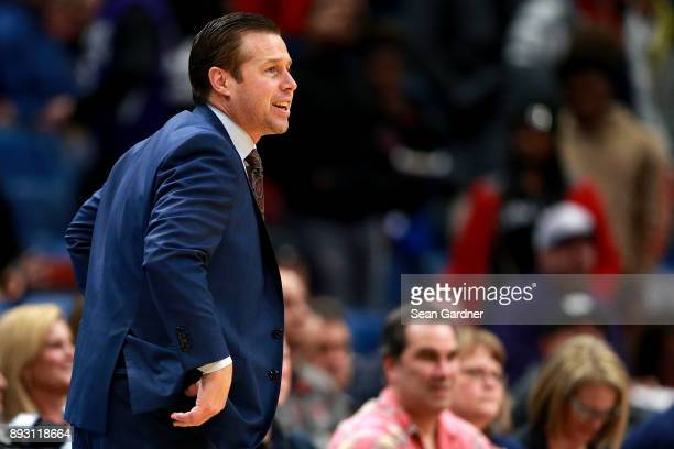 David Joerger of the Sacramento Kings insturcts his team during the second half of a NBA game against the New Orleans Pelicans at the Smoothie King...