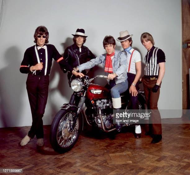 David John Harman , known professionally as Dave Dee , poses with friends and bandmates Trevor Leonard Ward-Davies , John Dymond , Michael Wilson and...