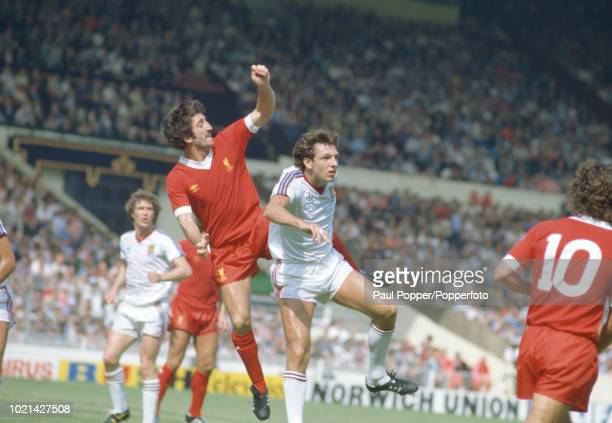 David Johnson of Liverpool and Alvin Martin of West Ham United battle for the ball during the FA Charity Shield at Wembley Stadium on August 9 1980...