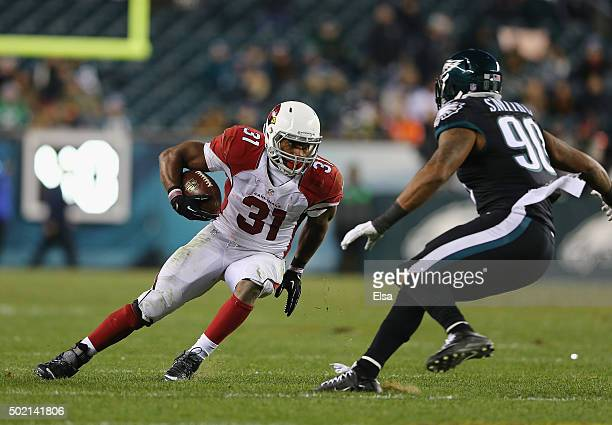 David Johnson of the Arizona Cardinals carries the ball against Marcus Smith of the Philadelphia Eagles in the fourth quarter at Lincoln Financial...