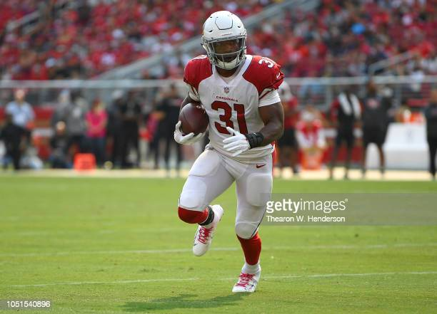David Johnson of the Arizona Cardinals carries the ball against the San Francisco 49ers during the second quarter of their NFL football game at...