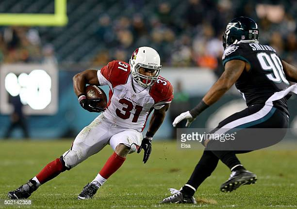 David Johnson of the Arizona Cardinals carries the ball as Marcus Smith of the Philadelphia Eagles defends in the fourth quarter at Lincoln Financial...