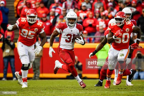 David Johnson of the Arizona Cardinals carries the ball on a rush during the second half of the game against the Kansas City Chiefs at Arrowhead...