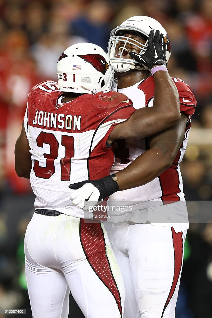 David Johnson #31 of the Arizona Cardinals celebrates after a touchdown with D.J. Humphries #74 during their NFL game against the San Francisco 49ers at Levi's Stadium on October 6, 2016 in Santa Clara, California.