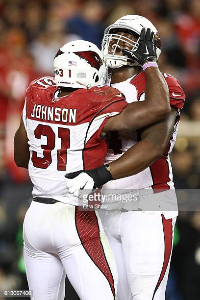 David Johnson of the Arizona Cardinals celebrates after a touchdown with DJ Humphries during their NFL game against the San Francisco 49ers at Levi's...
