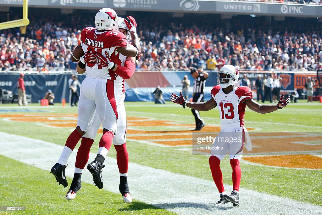 David Johnson #31 of the Arizona Cardinals celebrates with teammates after returning the opening kickoff 108 yards for a touchdown against the Chicago Bears at Soldier Field on September 20, 2015 in Chicago, Illinois.