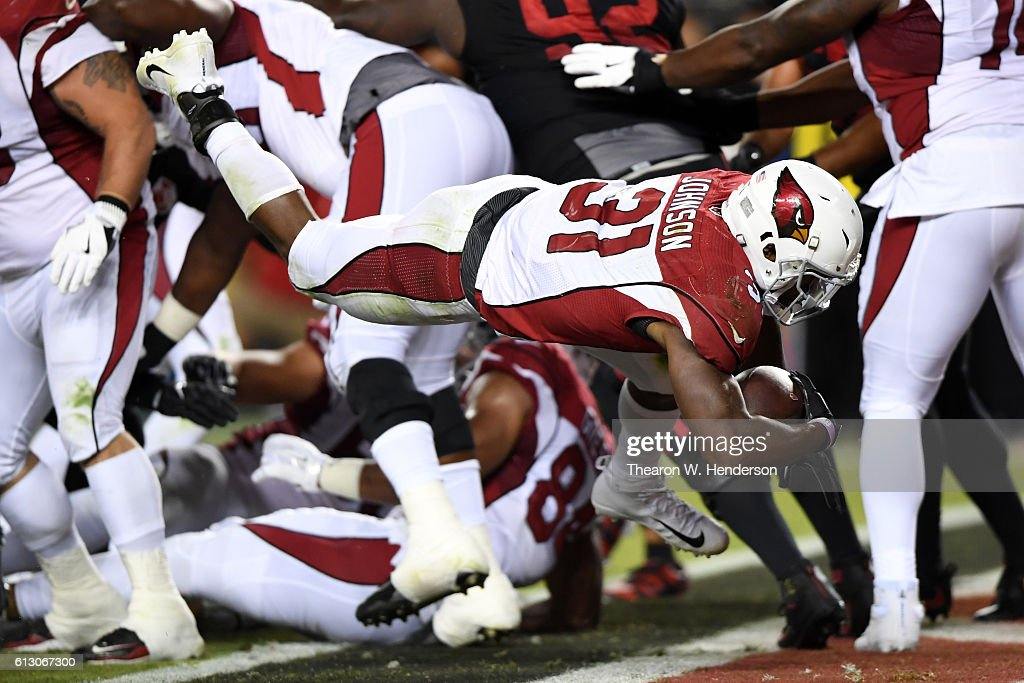David Johnson #31 of the Arizona Cardinals dives into the endzone for a touchdown against the San Francisco 49ers during their NFL game at Levi's Stadium on October 6, 2016 in Santa Clara, California.