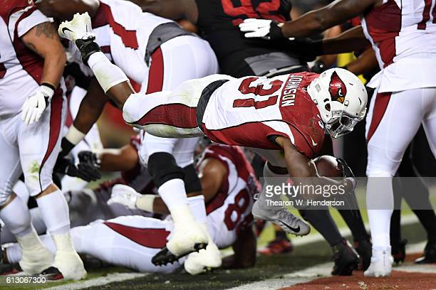 David Johnson of the Arizona Cardinals dives into the endzone for a touchdown against the San Francisco 49ers during their NFL game at Levi's Stadium...
