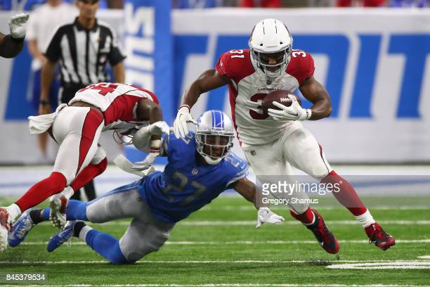 David Johnson of the Arizona Cardinals escapes the tackle of Glover Quin of the Detroit Lions during a second half run at Ford Field on September 10...