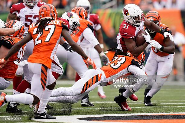 David Johnson of the Arizona Cardinals is tackled by B.W. Webb of the Cincinnati Bengals during the NFL football game at Paul Brown Stadium on...