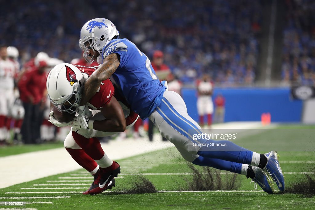 David Johnson #31 of the Arizona Cardinals is tackled by Darius Slay #23 of the Detroit Lions after a first half catch at Ford Field on September 10, 2017 in Detroit, Michigan. Detroit won the game 35-23.