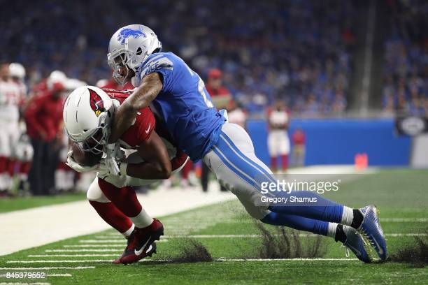 David Johnson of the Arizona Cardinals is tackled by Darius Slay of the Detroit Lions after a first half catch at Ford Field on September 10, 2017 in...