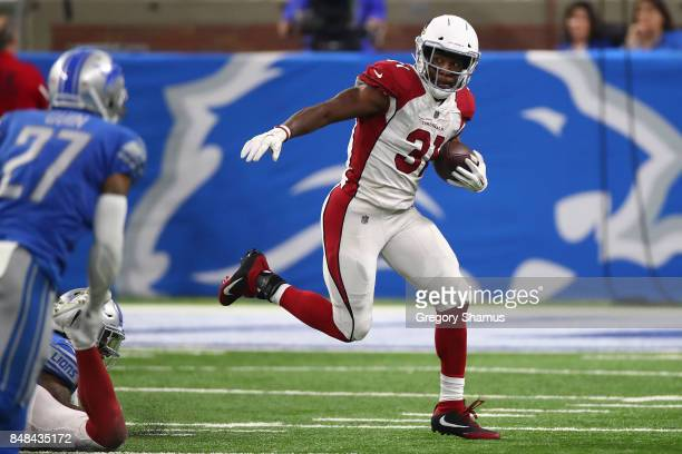 David Johnson of the Arizona Cardinals looks for yards during a run while playing the Detroit Lions at Ford Field on September 10 2017 in Detroit...