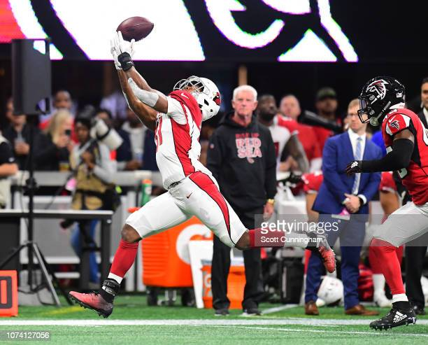 David Johnson of the Arizona Cardinals makes a first quarter catch against the Atlanta Falcons at MercedesBenz Stadium on December 16 2018 in Atlanta...