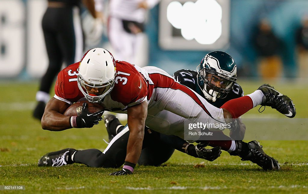 David Johnson #31 of the Arizona Cardinals makes a first-down catch in the third quarter against Malcolm Jenkins #27 of the Philadelphia Eagles at Lincoln Financial Field on December 20, 2015 in Philadelphia, Pennsylvania.
