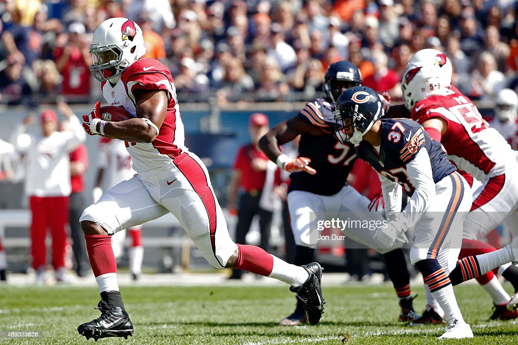 David Johnson #31 of the Arizona Cardinals returns the opening kickoff for a touchdown against the Chicago Bears during the first quarter at Soldier Field on September 20, 2015 in Chicago, Illinois.
