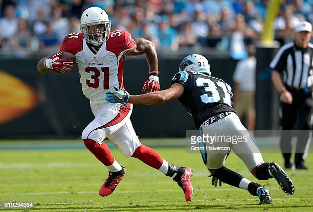 David Johnson of the Arizona Cardinals runs the ball against Zack Sanchez of the Carolina Panthers in the 4th quarter during the game at Bank of...