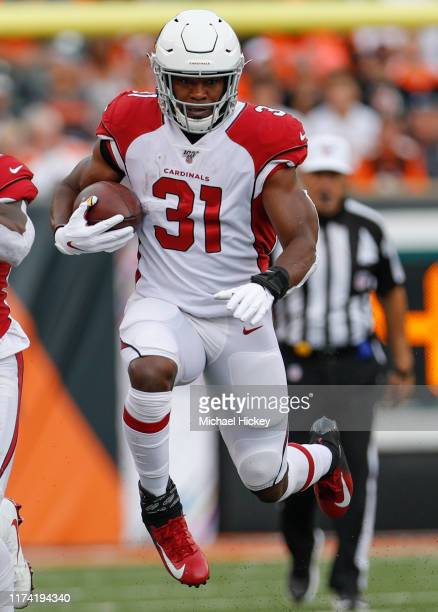 David Johnson of the Arizona Cardinals runs the ball during the first half against the Cincinnati Bengals at Paul Brown Stadium on October 6 2019 in...