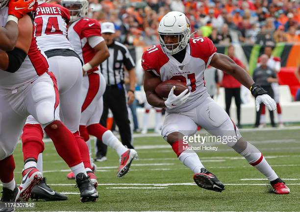 David Johnson of the Arizona Cardinals runs the ball during the game against the Cincinnati Bengals at Paul Brown Stadium on October 6 2019 in...