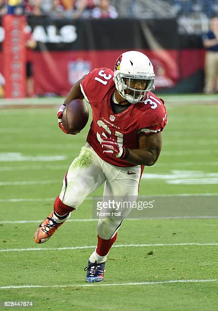 David Johnson of the Arizona Cardinals runs with the ball against the Washington Redskins at University of Phoenix Stadium on December 4 2016 in...