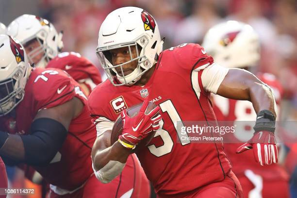 David Johnson of the Arizona Cardinals runs with the football in the first half of the NFL game against the Los Angeles Rams at State Farm Stadium on...