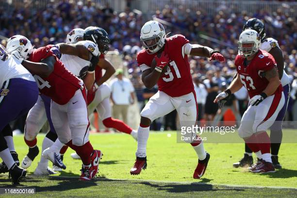 David Johnson of the Arizona Cardinals rushes for a touchdown against the Baltimore Ravens during the second half at M&T Bank Stadium on September...