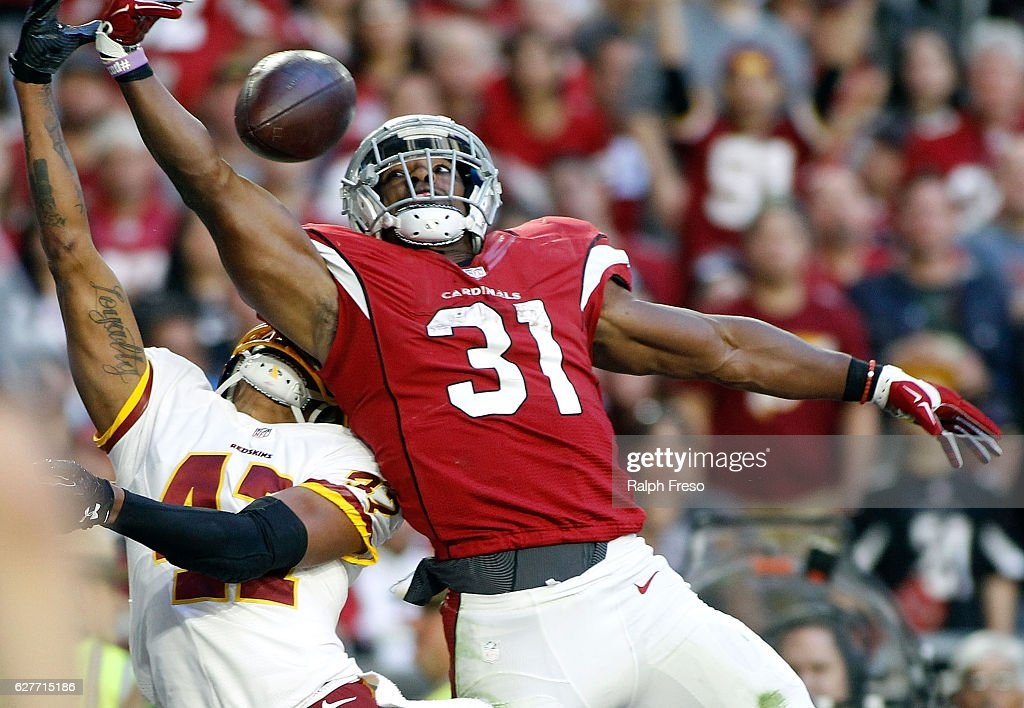 David Johnson #31 of the Arizona Cardinals tries to make a one handed catch in the endzone as Quinton Dunbar #47 of the Washington Redskins defends during the third quarter of a game at University of Phoenix Stadium on December 4, 2016 in Glendale, Arizona. The Cardinals defeated the Redskins 31-23.
