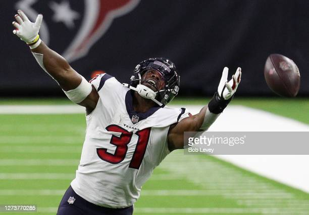 David Johnson of the Houston Texans misses a pass against the Baltimore Ravens during the second half at NRG Stadium on September 20, 2020 in...