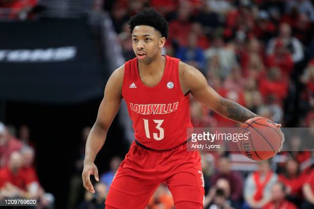 David Johnson of the Louisville Cardinals dribbles the ball against the Virginia Tech Hokies at KFC YUM! Center on March 01, 2020 in Louisville,...
