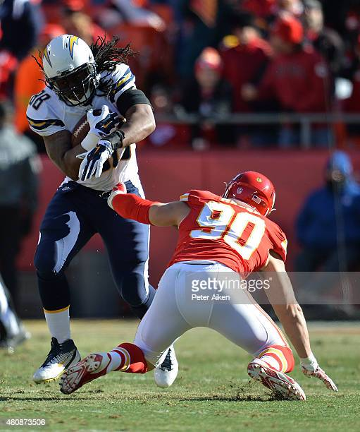 David Johnson of the San Diego Chargers runs the ball against Josh Mauga of the Kansas City Chiefs during the first half at Arrowhead Stadium on...
