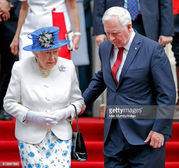 David Johnston, Governor General of Canada, holds Queen Elizabeth II's arm as she departs Canada House after attending a celebration to mark Canada's...