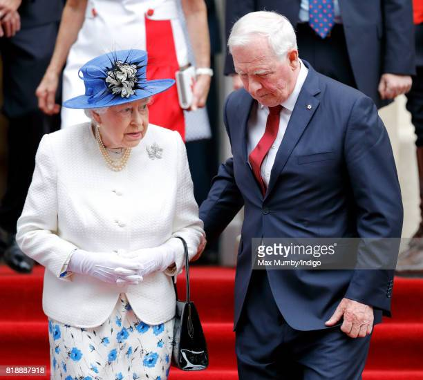 David Johnston Governor General of Canada holds Queen Elizabeth II's arm as she departs Canada House after attending a celebration to mark Canada's...