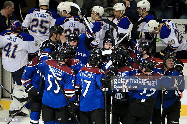 David Jones of the Colorado Avalanche is swarmed by his teammates after scoring the game winning goal in overtime against Jaroslav Halak of the St....