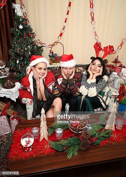 David Jones ambassadors, Jesinta Campbell, Jason Dundas and Jessica Gomes pose in Christmas themed clothing at the David Jones Christmas cocktail...