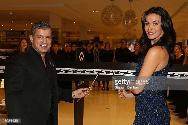 David Jones CEO and Managing Director Paul Zahra and David Jones Brand Ambassador Megan Gale cut the ribbon to officially open the new David Jones...
