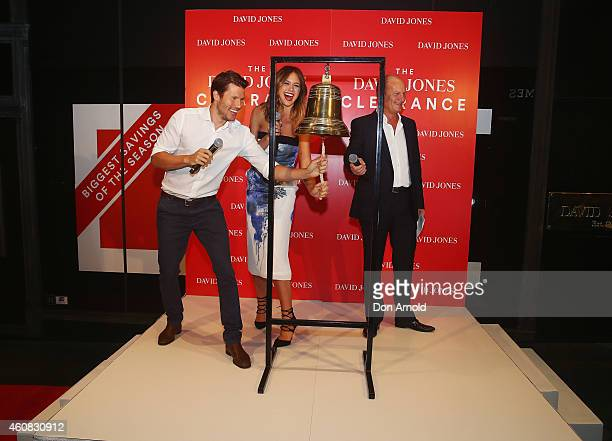 David Jones CEO Iain Nairn looks on as ambassadors Jason Dundas and Jesinta Campbell ring the bell to announce the start of the Boxing Day Sales at...