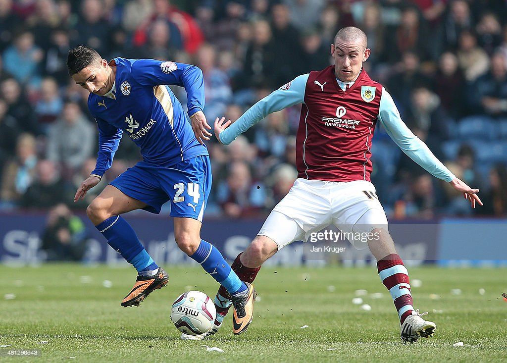 David Jones of Burnley battles with Anthony Knockaert of Leicester City during the Sky Bet Championship match between Burnley and Leicester City at Turf Moor on March 29, 2014 in Burnley, England.