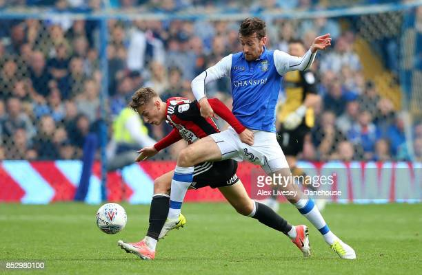 David Jones of Sheffield Wednesday tackles David Brooks of Sheffield United during the Sky Bet Championship match between Sheffield Wednesday and...