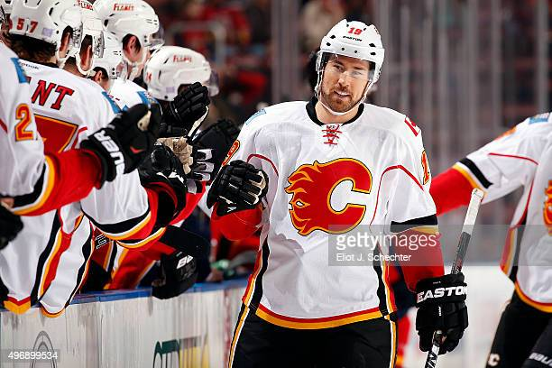 David Jones of the Calgary Flames celebrates a goal with teammates against the Florida Panthers at the BBT Center on November 10 2015 in Sunrise...