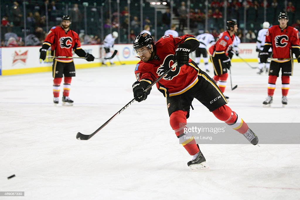 David Jones #19 of the Calgary Flames shoots the puck during the warmups against the Los Angeles Kings at Scotiabank Saddledome on April 9, 2015 in Calgary, Alberta, Canada.