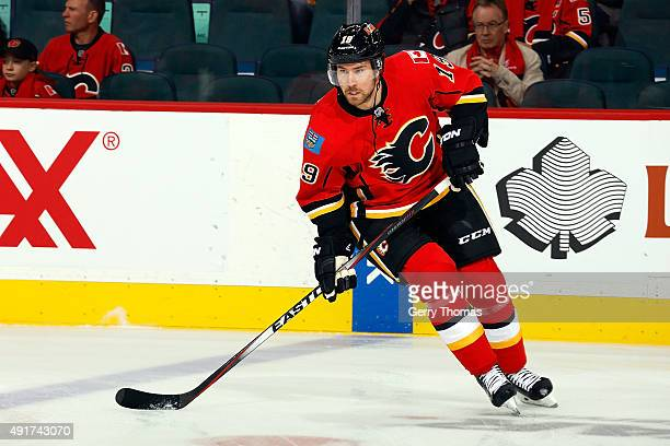 David Jones of the Calgary Flames skates during the warmup before the NHL season opener against the Vancouver Canucks at Scotiabank Saddledome on...