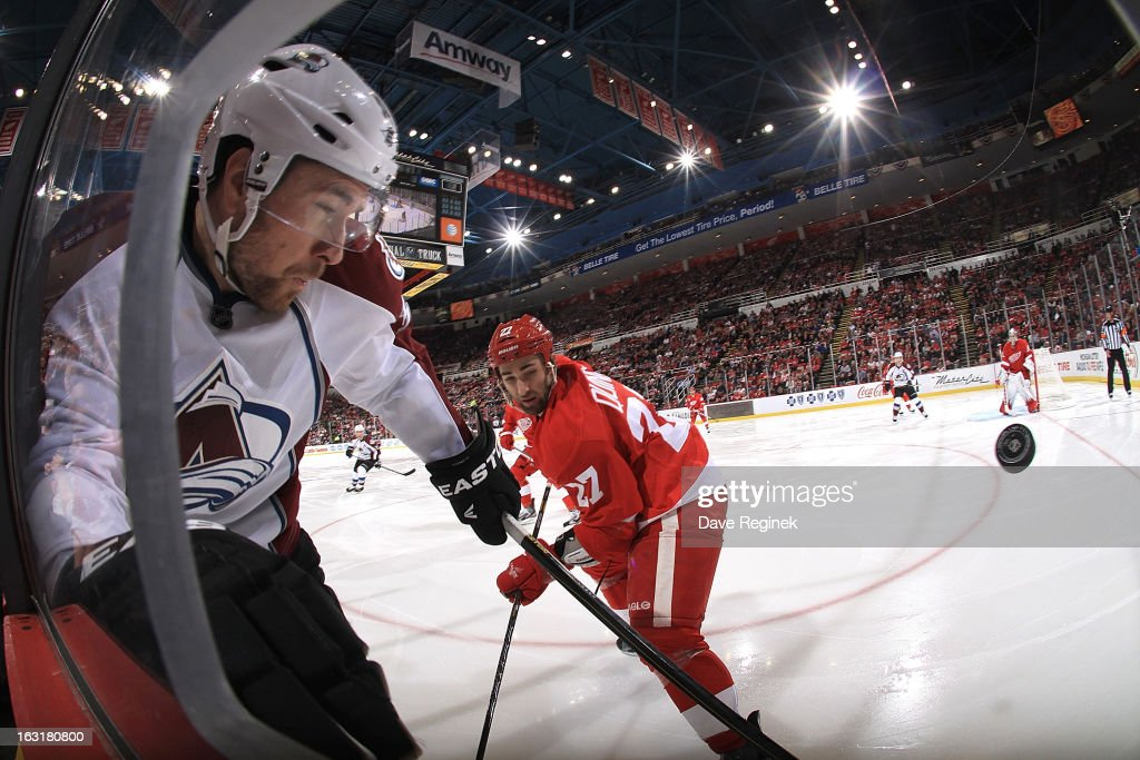David Jones #54 of the Colorado Avalanche and Kyle Quincey #27 of the Detroit Red Wings battle in the corner for the puck during a NHL game at Joe Louis Arena on March 5, 2013 in Detroit, Michigan. The Wings won 2-1