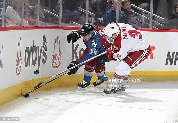 David Jones of the Colorado Avalanche skates against Keith Yandle of the Phoenix Coyotes at the Pepsi Center on February 11 2013 in Denver Colorado