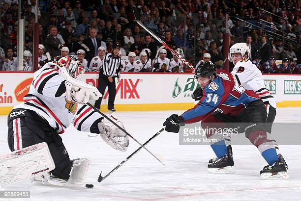 David Jones of the Colorado Avalanche takes a shot against goaltender Antti Niemi and Duncan Keith of the Chicago Blackhawks at the Pepsi Center on...