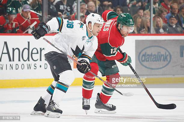 David Jones of the Minnesota Wild and Micheal Haley of the San Jose Sharks await a faceoff during the game on April 5 2016 at the Xcel Energy Center...